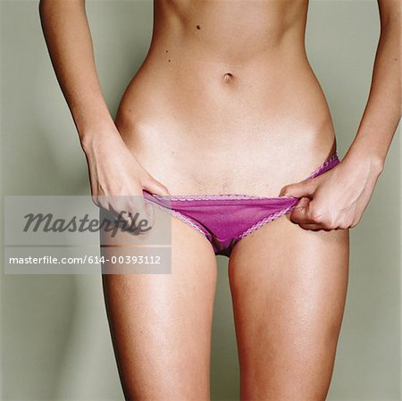 Female midriff Stock Photo - Premium Royalty-Free, Image code: 614-00393112