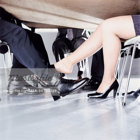 Businesspeople playing footsie