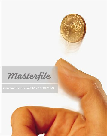 Hand tossing coin Stock Photo - Premium Royalty-Free, Image code: 614-00397159
