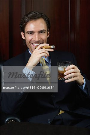 Wealthy businessman Stock Photo - Premium Royalty-Free, Image code: 614-00891034