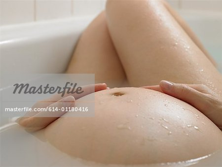 Pregnant woman bathing Stock Photo - Premium Royalty-Free, Image code: 614-01180416