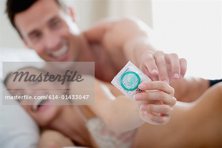 Couple with a condom Stock Photo - Premium Royalty-Free, Image code: 614-01433047