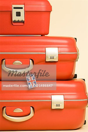 Stack of suitcases with british flag tag Stock Photo - Premium Royalty-Free, Image code: 614-01486647
