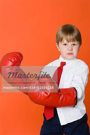 Boy wearing boxing gloves Stock Photo - Premium Royalty-Free, Image code: 614-01559138