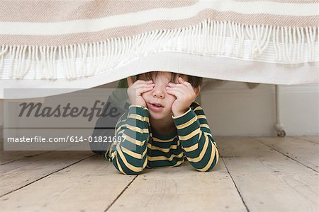 Boy playing hide and seek Stock Photo - Premium Royalty-Free, Image code: 614-01821687