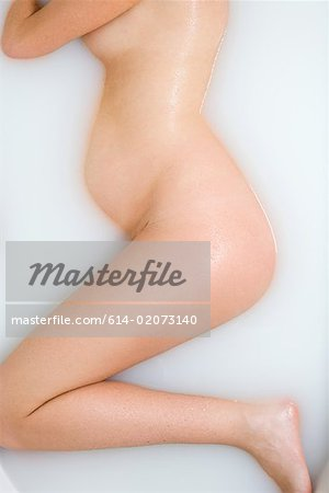 Pregnant woman bathing Stock Photo - Premium Royalty-Free, Image code: 614-02073140