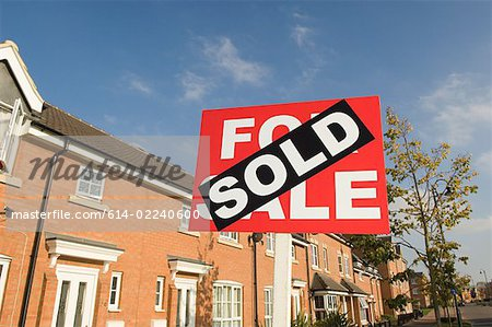 Sold sign and houses Stock Photo - Premium Royalty-Free, Image code: 614-02240600