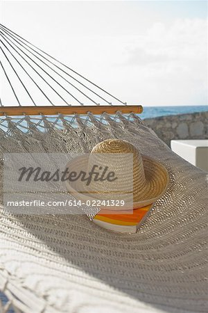 Hat and book on hammock Stock Photo - Premium Royalty-Free, Image code: 614-02241329