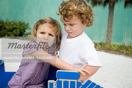 Sister and brother fighting Stock Photo - Premium Royalty-Free, Image code: 614-02241485