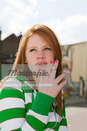 Teenage girl smoking Stock Photo - Premium Royalty-Free, Image code: 614-02243754