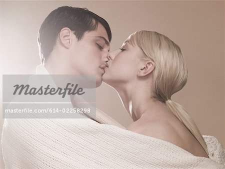 Couple kissing Stock Photo - Premium Royalty-Free, Image code: 614-02258298