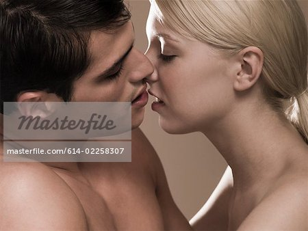 Couple kissing Stock Photo - Premium Royalty-Free, Image code: 614-02258307