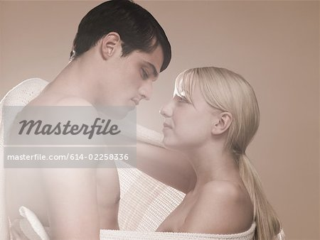 Young couple gazing at each other Stock Photo - Premium Royalty-Free, Image code: 614-02258336