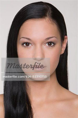 Portrait of a young woman Stock Photo - Premium Royalty-Free, Image code: 614-02393710