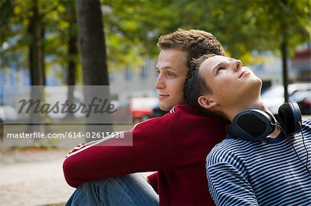 A gay couple back to back Stock Photo - Premium Royalty-Free, Image code: 614-02613438