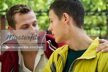 A gay couple looking at each other Stock Photo - Premium Royalty-Free, Image code: 614-02613440