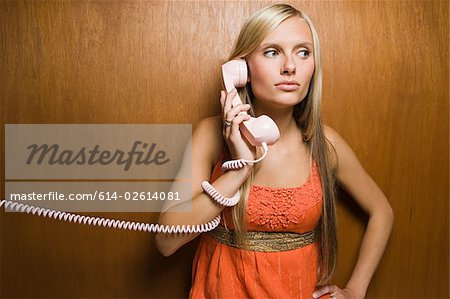 Young woman on telephone Stock Photo - Premium Royalty-Free, Image code: 614-02614081