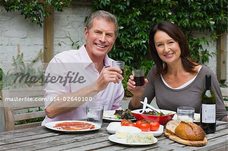 Mature woman and senior man dining al fresco Stock Photo - Premium Royalty-Free, Image code: 614-02640100