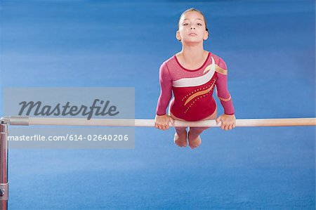 Gymnast on unparallel bars Stock Photo - Premium Royalty-Free, Image code: 614-02640206