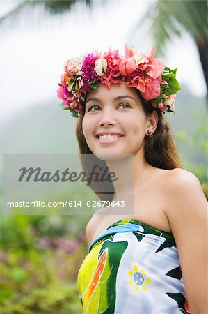 Young woman with flowers in hair in moorea Stock Photo - Premium Royalty-Free, Image code: 614-02679643