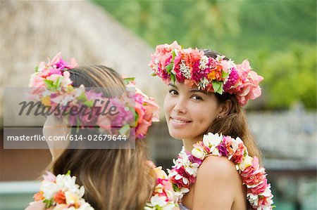 Young women with flowers in hair in moorea Stock Photo - Premium Royalty-Free, Image code: 614-02679644