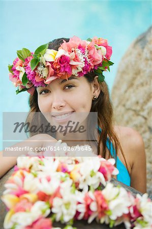Young woman with flowers in hair in moorea Stock Photo - Premium Royalty-Free, Image code: 614-02679645