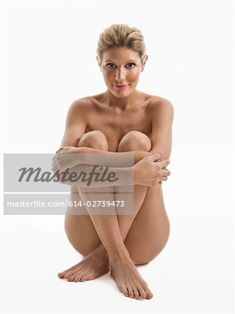 Nude woman sitting Stock Photo - Premium Royalty-Free, Image code: 614-02739473
