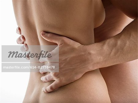 Nude couple hugging Stock Photo - Premium Royalty-Free, Image code: 614-02739478