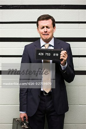 Mugshot of businessman Stock Photo - Premium Royalty-Free, Image code: 614-02739970