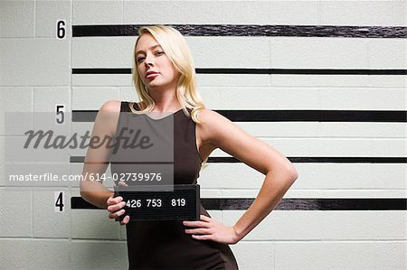 Mugshot of female criminal Stock Photo - Premium Royalty-Free, Image code: 614-02739976