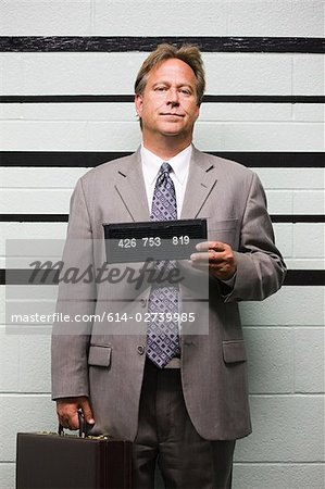 Mugshot of businessman Stock Photo - Premium Royalty-Free, Image code: 614-02739985