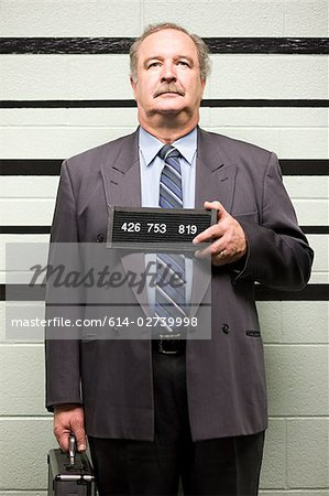 Mugshot of businessman Stock Photo - Premium Royalty-Free, Image code: 614-02739998