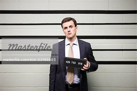 Mugshot of businessman Stock Photo - Premium Royalty-Free, Image code: 614-02740003