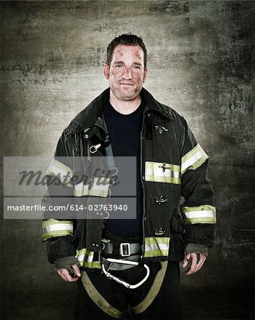 Portrait of a firefighter Stock Photo - Premium Royalty-Free, Image code: 614-02763940