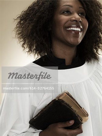 A gospel singer holding a bible Stock Photo - Premium Royalty-Free, Image code: 614-02764155