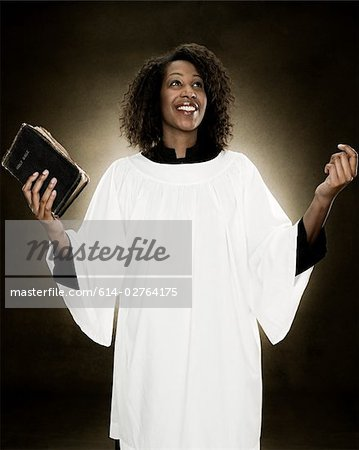A gospel singer holding a bible Stock Photo - Premium Royalty-Free, Image code: 614-02764175