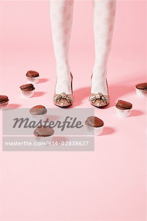 Legs of  woman and cakes Stock Photo - Premium Royalty-Free, Image code: 614-02838627