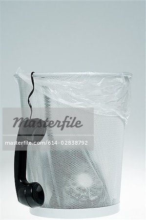 Telephone in a bin Stock Photo - Premium Royalty-Free, Image code: 614-02838792