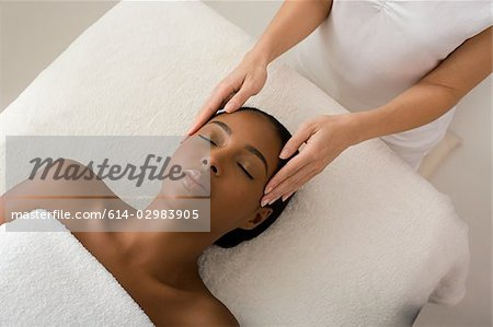 Woman having a head massage Stock Photo - Premium Royalty-Free, Image code: 614-02983905