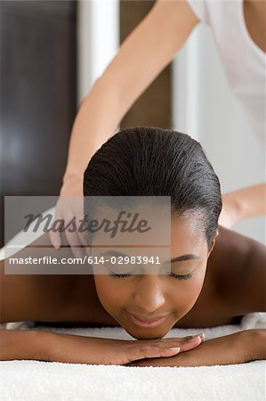 Woman having a massage Stock Photo - Premium Royalty-Free, Image code: 614-02983941
