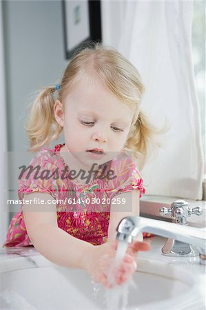 Girl washing her hands Stock Photo - Premium Royalty-Free, Image code: 614-03020259