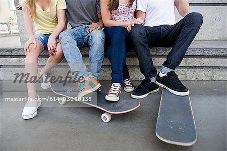 Teenagers with skateboards Stock Photo - Premium Royalty-Free, Image code: 614-03080138