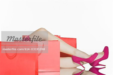 Shoes of woman and shopping bags Stock Photo - Premium Royalty-Free, Image code: 614-03191288