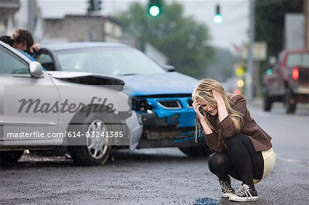 Young woman involved in road accident Stock Photo - Premium Royalty-Free, Image code: 614-03241385