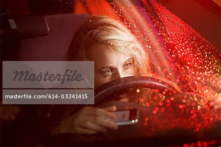 Young woman in car accident Stock Photo - Premium Royalty-Free, Image code: 614-03241415