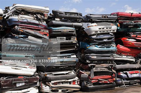 Stacks of crushed cars Stock Photo - Premium Royalty-Free, Image code: 614-03393903