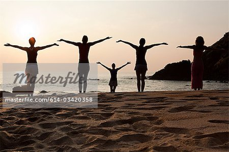 Women practicing yoga on beach at sunset Stock Photo - Premium Royalty-Free, Image code: 614-03420358