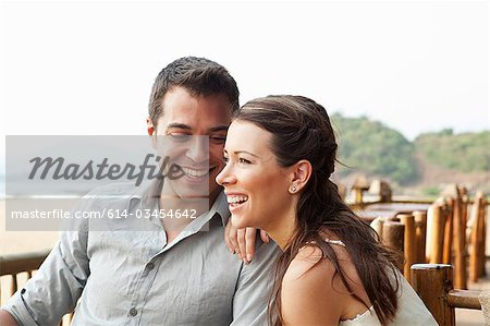 Couple at beach bar Stock Photo - Premium Royalty-Free, Image code: 614-03454642