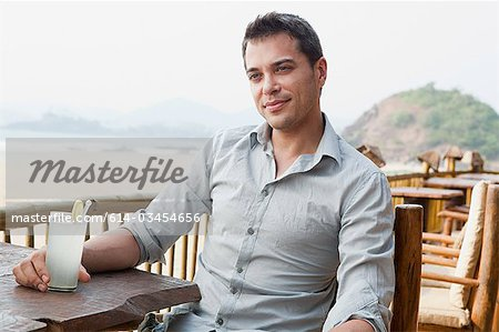 Man at beach bar Stock Photo - Premium Royalty-Free, Image code: 614-03454656
