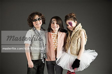 Three young friends dressed up Stock Photo - Premium Royalty-Free, Image code: 614-03469522